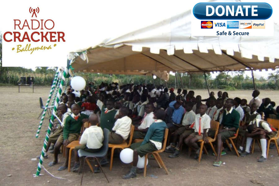 African outdoor classroom full of students on seats